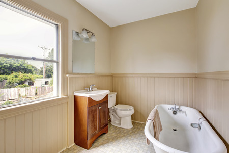 Traditional bathroom interior with tube and tile floor. Northwest, USA