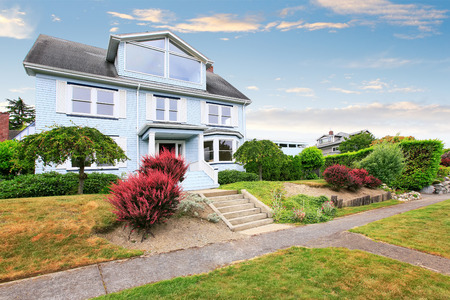 curb appeal: Traditional three story house exterior with well kept garden around. Curb appeal. Northwest, USA