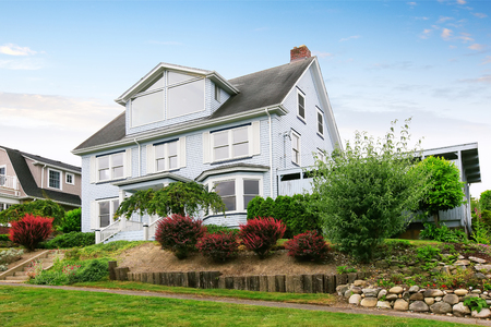 curb: Traditional three story house exterior with well kept garden around. Curb appeal. Northwest, USA