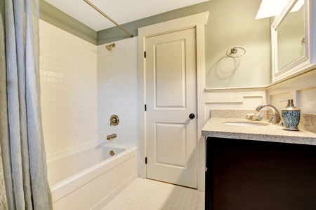 Bathroom interior in white and blue tones with black vanity cabinet. Northwest, USA Stock Photo