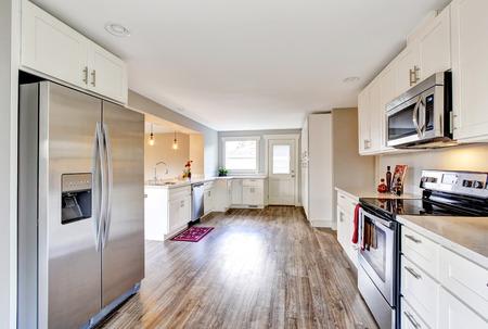 open floor plan: Open floor plan white kitchen room interior with polished hardwood floor. Northwest, USA Stock Photo