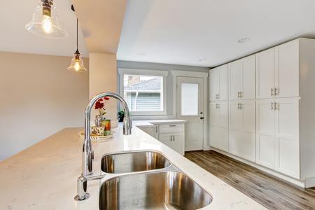 granite kitchen: Bright kitchen room with steel appliances and granite tops. Northwest, USA