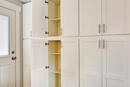dryer  estate: White big wooden storage combination for kitchen room. Northwest, USA
