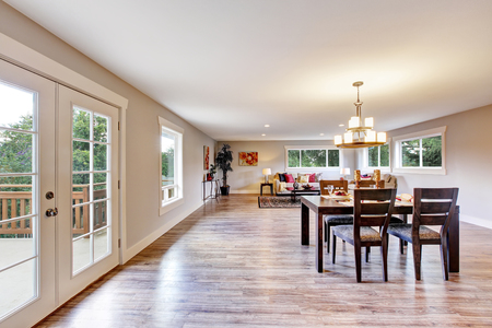open floor plan: Open floor plan spacious room interior. Dining area with dark brown wooden table set. Northwest, USA Stock Photo