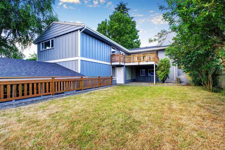 garden styles: Spacious wooden fenced backyard area. Countryside blue house. Northwest, USA