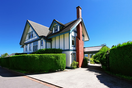 Craftsman style American house exterior with white and blue trim. Northwest, USA Stock Photo