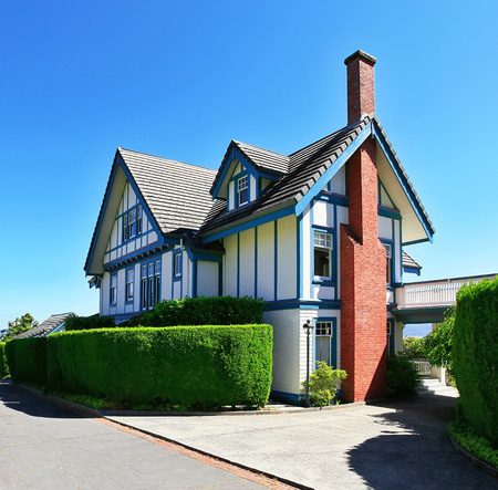 white trim: Craftsman style American house exterior with white and blue trim. Northwest, USA Stock Photo