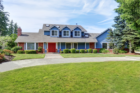 white trim: American house exterior with blue and white trim. Also red front door, well kept garden and driveway. Northwest, USA Stock Photo