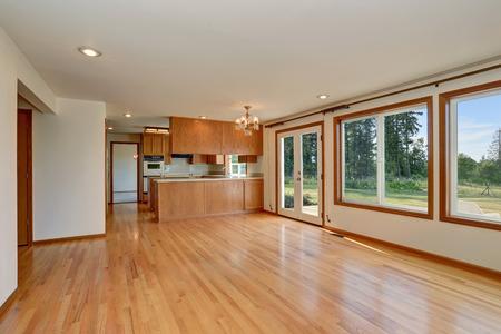 Open floor plan. Kitchen room interior with wooden cabinets  and hardwood floor. Northwest, USA