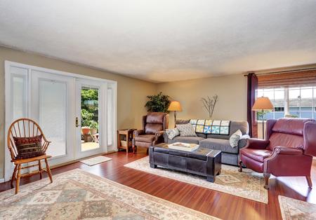 traditional living room: Traditional living room interior with fireplace, hardwood floor and rug. Northwest, USA Stock Photo