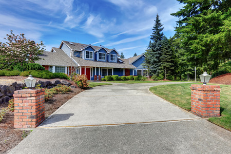 white trim: American house exterior with blue and white trim and red front door, well kept garden and driveway. Northwest, USA