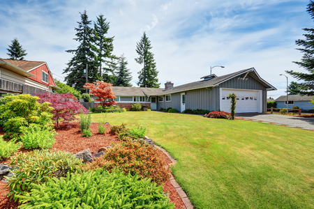 American house exterior with garage, driveway and well kept lawn. Northwest, USA Stock Photo