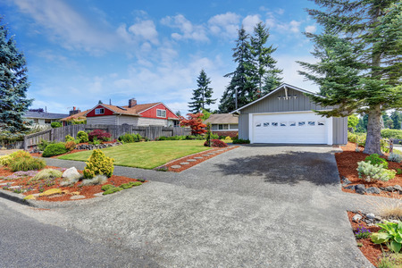 american house: American house exterior with garage, driveway and well kept lawn. Northwest, USA Stock Photo