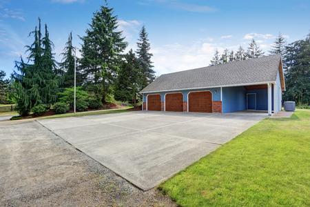 trim: Three garages with blue and brick trim. Northwest, USA