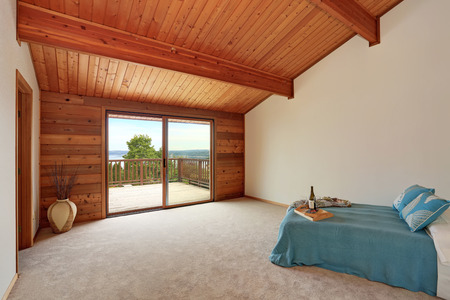 remodeled: Empty room interior with wooden panel trim walls. Also one bed with blue bedding. Northwest, USA