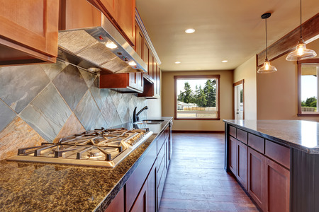 open floor plan: Open floor plan. Kitchen room interior with wooden cabinets, island and granite counter top. Northwest, USA Stock Photo