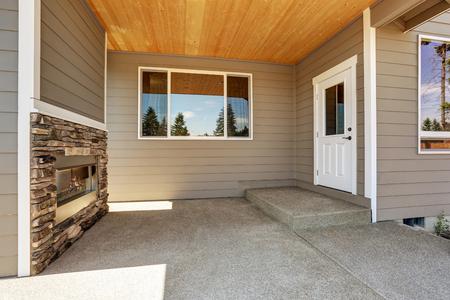 stone fireplace: Backyard concrete floor patio area with stone fireplace. Northwest, USA Stock Photo