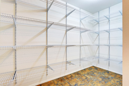 walk in closet: Large walk in closet with tile floor, also including many shelves. Northwest, USA