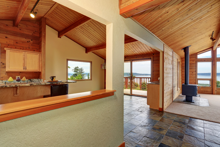 Wooden trim home with open floor plan. Kitchen with granite counter top and wooden ceiling. Perfect water view. Northwest, USA