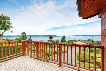 Unfurnished and empty balcony with perfect water view and wooden railings. Northwest, USA