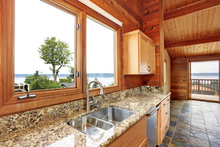 open floor plan: Wooden trim home with open floor plan. Kitchen with granite counter top and wooden ceiling. Perfect water view. Northwest, USA