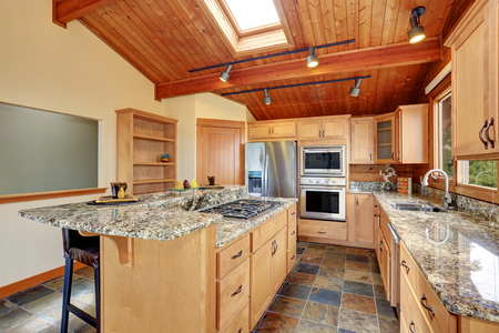 open floor plan: Wooden trim home with open floor plan. Kitchen with granite counter top. Perfect water view. Northwest, USA