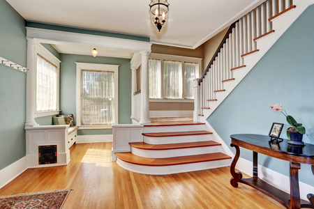 stairs interior: Hallway interior in blue tones, columns and hardwood floor. View of stairs. Northwest, USA Stock Photo