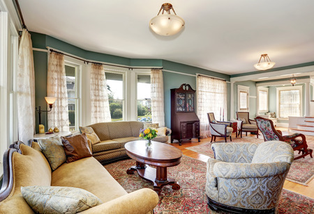 traditional living room: Traditional living room interior in blue and white tones. Also many windows with white curtains. Northwest, USA