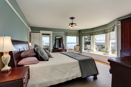 king size bed: Luxury bedroom interior in blue tones and king size bed. Also perfect water view. Northwest, USA