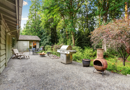 fire pit: Vintage back patio with fire pit, furniture, and lots of greenery. Northwest, USA