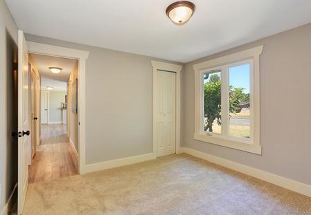 remodeled: Empty room interior with carpet floor. Open door to the hallway with hardwood floor. Northwest, USA Stock Photo