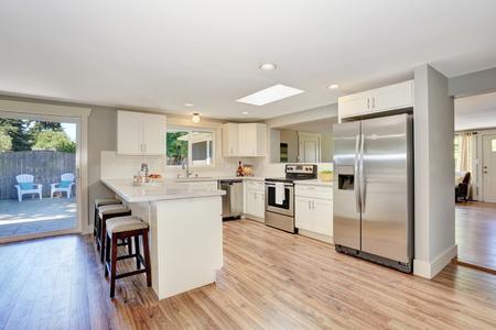 open floor plan: Modern kitchen room interior in white tones with hardwood floor. Open floor plan. Northwest, USA
