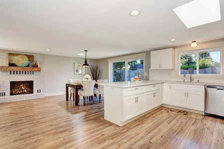 open plan: Modern kitchen room interior in white tones with hardwood floor. Open floor plan. Northwest, USA