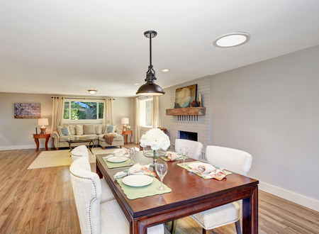 open floor plan: Open floor plan dining area with elegant table setting and white soft chairs. Northwest, USA