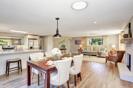 dining table and chairs: Open floor plan dining area with elegant table setting and white soft chairs. Northwest, USA