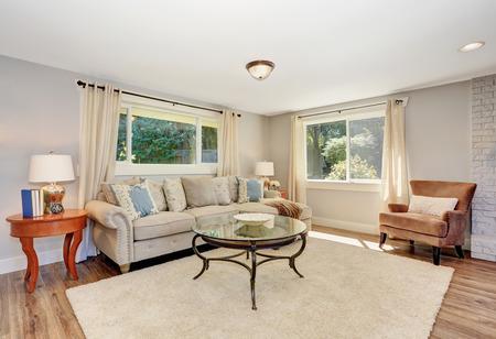 floor rug: Open floor plan living room interior in white tones with hardwood floor, rug and nice coffee table. Northwest, USA