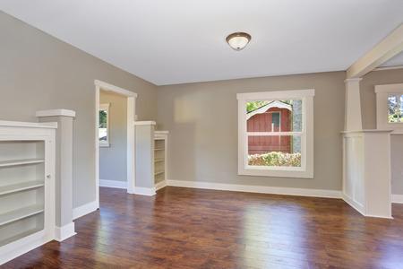open floor plan: Open floor plan. Empty hallway interior with dark brown hardwood floor. Northwest, USA