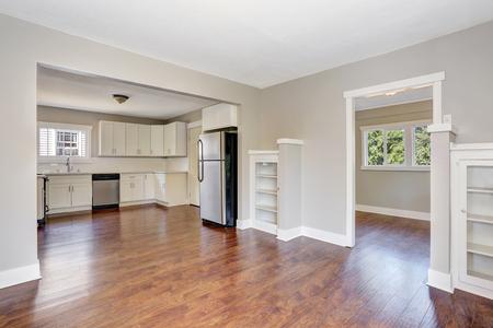 open floor plan: Open floor plan. White kitchen room interior with marble counter top and hardwood floor. Northwest, USA