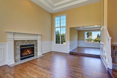 open floor plan: Open floor plan living room interior with hardwood floor and fireplace. Northwest, USA