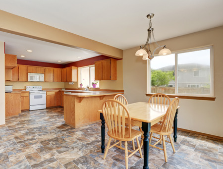 Classic kitchen room interior with tile floor and dining area. Northwest, USA