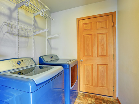 laundry room: Laundry room interior with blue washer and dryer. Also shelves. Northwest, USA