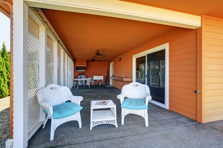 northwest: Cozy covered patio area of orange house, Northwest, USA