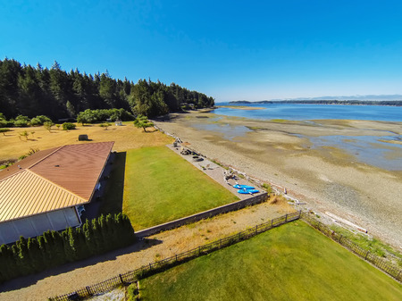 Aerial view of waterfront house with perfect landscape. Northwest, USA