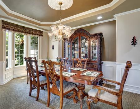 Gorgeous Dining Room Interior Design With Vintage Furniture, French  Windows. Elegant Chandelier Above Carved