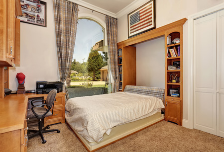 Home office interior in mansion-house. Has large arched window and folding wall bed. Northwest, USA Banco de Imagens