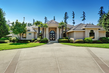 Suburban Luxury residential house with Perfect landscape design and blue sky background. Northwest, USA