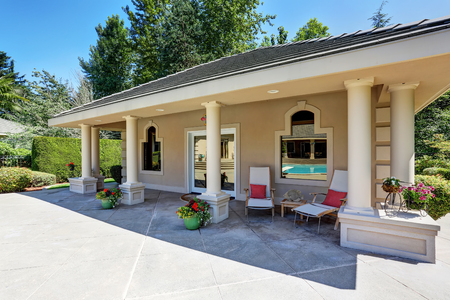 guest house: View of luxury guest house with column porch. American Suburban house exterior.Northwest, USA Stock Photo