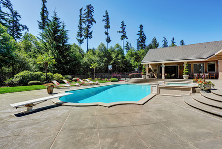 Great backyard with swimming pool .American Suburban luxury house. Northwest, USA