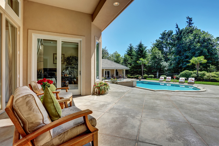 seating area: Relaxing outdoor seating arrangement overlooking swimming pool. Luxury house exterior. Northwest, USA