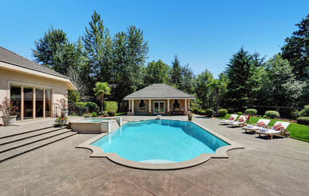 Large swimming pool of American Suburban luxury house. Northwest, USA